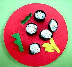 Paper Sushi: Could be nice if the craft is presented on a Japanese-like plate/ Sushi package.