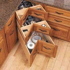 Love this idea for a set of corner kitchen drawers!