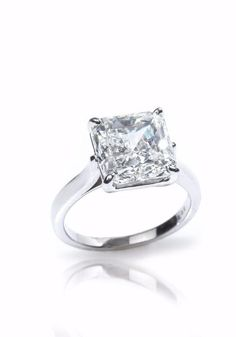 Louis Glick - Starburst Diamond Platinum Solitaire Ring from Osterjewelers.com