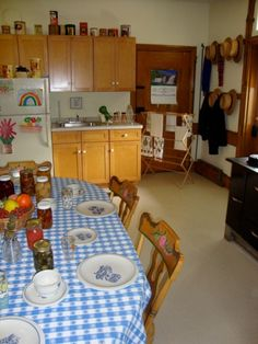The Amish farmhouse  -pretty much like most kitchens, except for the canned goods on the table. :-)
