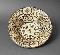 Bowl Iran, Nishapur Bowl, 10th century Ceramic; Vessel, Earthenware, white slip, slip-painted in yellow-staining black, 3 x 10 1/8 in. (7.62 x 25.72 cm) Art Museum Council Fund (M.68.22.11) Art of the Middle East: Islamic Department.