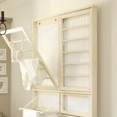 pull down drying rack; perhaps on the side of the cabinet in between