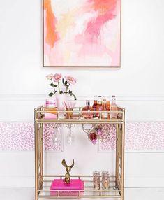 Bright pink and gold bar cart setup