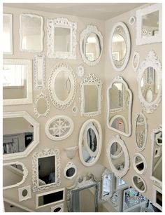 'Thrift store' mirror display... up the staircase... Love this!  Who lives in this magical world where you find these things in thrift shops?!