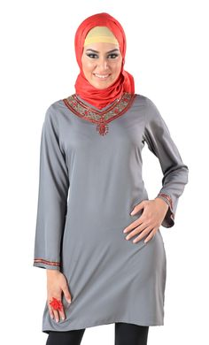 Depicted here is a pleasant dark grey kurti woven out of 100% poly crepe fabric. Also available in pure black when it comes to color this kurti has been designed with beauty in mind. This modest kurti has a design pattern comprising of laces as well as sequins which come together to form an elegant imagery around the neckline and at the cuffs of the garment.