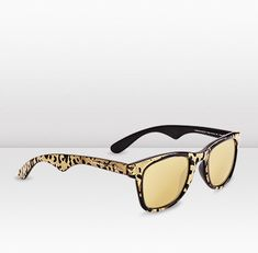 Jimmy Choo 'Carrera Real Gold Leopard' - Jimmy Choo and Carrera have taken luxury to a new level by using gold plated lenses for a truly decadent finish.