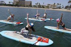 YOGAqua on paddleboards in the waters of Marina Del Rey Harbor. Taught by Sarah Tiefenthaler, far right.  Photo by Brad Graverson/SCNG/ 08-26-16