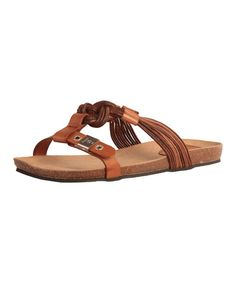 Nothing beats classic style, and this comfy slip-on sandal is no exception. Crafted in supple leather and finished with a decorative buckle, it makes a timeless addition to any ensemble.Leather upperSuede liningMan-made soleImported
