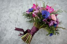Woodland Elegance Winter Bridal Bouquet Inspiration with #anemones and #ranunculus. Photo: www.tarawhittaker.com Bouquet: www.flowersbyjanie.com #Calgaryweddingflorist #Winterweddingsinspiration #winterbridalbouquet #anemonebouquet #purpleandpinkbouquet
