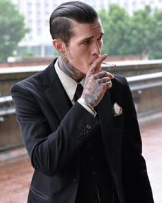 """""""I loved those symbols of the past.  Where he had been, what was important; what made him, him and what made him mine..."""" quote from """"Sex, Murder and the Three of Us"""".  Love the bad boy neck and hand tattoos with the upscale attire!"""