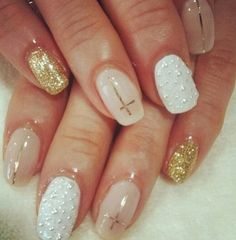 I don't necessarily like the gold polish, but definitely a fan of the white and neutral colors with the designs.