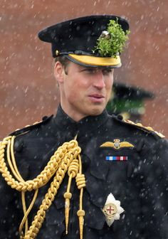 Prince William, Duke of Cambridge (in his role as Colonel of the Regiment) stands in the rain during the St Patrick's Day Parade at Mons Barracks on 17 March