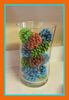 Multi-color painted pine cone diy home decor. Used vase = free cute home decor ♡ yay!