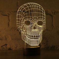 Studio Cheha in Tel Aviv, Israel is behind this innovative LED lamp that tricks your mind into thinking it's looking at a object. BULBING is a lamp created using wire-frame Luminaire Design, Lamp Design, Light Design, Skull 3d, Human Skull, Night Light, Light Up, Lamp Light, 3d Optical Illusions