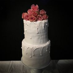 Double barrel two tier drip cake made with Wilton candy melts,  fondant, fresh cinnamon and harmony roses