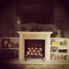 #DIY fireplace idea for #summer. Get the #glow without overheating!Our house doesn't have a fireplace. Want to build a faux one. Need ideas. Must be white.