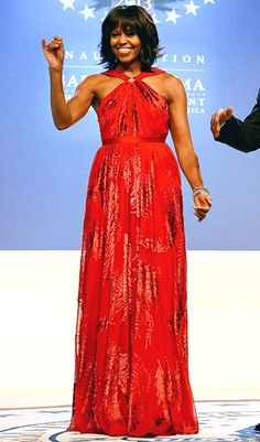 First Lady Michelle Obama wore a ruby chiffon and velvet Jason Wu gown.