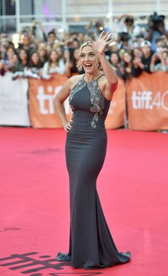 The star showed off her toned figure in a charcoal embellished Badgley Mischka gown and matching diamond ea...