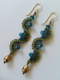 Love the waves being vertical! Blue Green & Bronze Wave Earrings by Jeka Lambert. Seed Bead Jewelry, Seed Bead Earrings, Beaded Earrings, Earrings Handmade, Beaded Jewelry, Handmade Jewelry, Seed Beads, Gold Jewelry, Gold Necklace