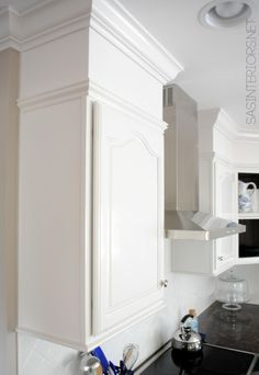 Basic upper cabinets with moulding added to give upscale built-in look; Progress pictures of a Kitchen Remodel featured in Kitchen + Bath Makeovers magazine