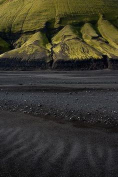 Arnessysla, Iceland - More surreal imagery from the Emstrur highlands - black sand and bright green moss-covered mountains | by janet little, via Flickr
