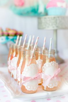 Pink Lemonade- We made by peeling of the stickers of Starbucks Frappuccino bottles and then taping on a doily and securing it with ribbon. We added an adorable striped straw to finish it off.
