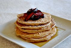 These fluffy, healthy and delicious vegan buttermilk pancakes topped with fresh plums and powdered sugar contain no unhealthy dairy.