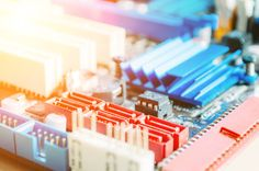 microcircuit board closeup for electronics and light background