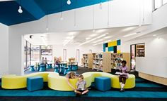 Colorful school interiors that promote both group work and solo reading. The designs and colors are real mood-brighteners!