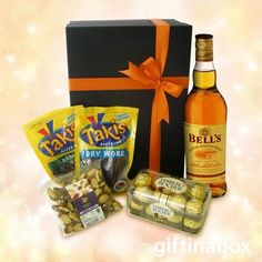 Bell's Whiskey gift hamper with Bells whiskey, biltong, dried wors, Brazil nuts and Ferrero Rocher chocolates. Perfect Father's day gift for him. Whiskey Gifts, Hamper Boxes, Gift Hampers, Special Day, Special Gifts, South African Wine, Ferrero Rocher Chocolates, Biltong