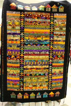 Canton Village Quilt Works - Love the flying geese sashing, the little houses, the narrow strips, the black border - everything! Creeper Minecraft, Embroidery Designs, Quilting Designs, African Quilts, African Fabric, African Textiles, Bright Quilts, Flying Geese Quilt, String Quilts