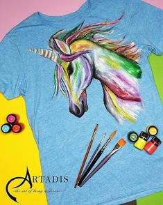#womanfashion #handpaintedclothing #tshirt #painting #clothing #unicorn #unicorns #loveunicorns #painting #handpainted #handmade #mywork #art #painted #thsirt #girftshop #gifts #artistsoninstagram #artist #artoninstagram #artonclothes #womanclothing #artadis #customize #top #personalizedgifts #textilepainting #fabricpainting #womenwear Painted Clothes, Fabric Painting, Unicorns, Personalized Gifts, Moose Art, Women Wear, Textiles, Hand Painted, Clothes For Women