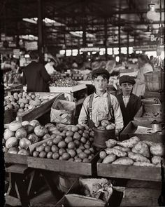 Indianapolis Fruit Market  Boys selling fruit and vegetables, August 1908. L. Hine