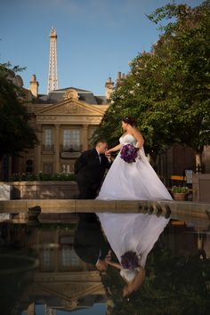 A romantic moment in the France Pavilion in Epcot. Photo: Stephanie, Disney Fine Art Photography