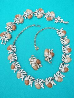 1950s Acorn themed necklace, bracelet and clip-on earrings set. Made with Thermoset faux wood cabochons. The necklace is an adjustable choker, classic style of this era. This necklace has a hook and chain for easy adjusting, bracelet has a very secure snap clasp, and the earrings are clip-on. I always consider myself lucky to find exquisite vintage jewelry sets in full. This would be a perfect gift for a close friend or loved one who appreciates mid-century classics, like old Hollywood…