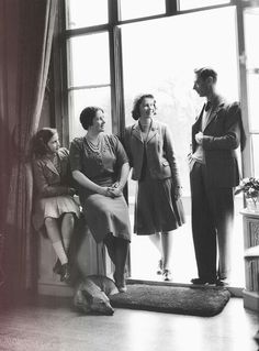 King George VI and his wife Queen Elizabeth with their children Princess Elizabeth and Princess Margaret.