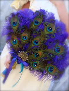 PACKAGE Renaissance Peacock bridal fan and 5 bridesmaid fans in your choice of colors. $350.00, via Etsy.