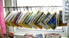 classroom collective • 'Classroom Organization' display a selection of magazines in page protectors clipped to curtain rod