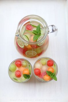 SUMMER SANGRIA moscato wine, a variety of melons – including watermelon, cantaloupe and honeydew melons – honey, lime, grappa, sparkling water, and mint.