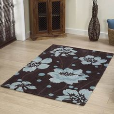 This ultra-cool coloured acrylic rug displays a beautiful floral design which is handmade in China. The large scale textured pattern includes flowers in shades of blue set on a rich chocolate background great for adding a luxurious look. Curtain Fabric, Curtains, Blue Chocolate, Textures Patterns, Shades Of Blue, Modern Design, Floral Design, Sweet Home, Carpet