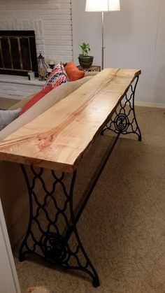 I made a table out of a wood slab and an old sewing machine base. : DIY