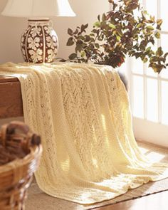 Featuring cable and lace details, this knit afghan is an elegant and cozy home decor essential. Shown in Waverly for Bernat