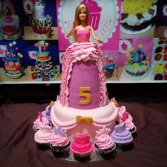 Barbie themed cake with cupcakes