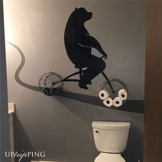 Mountain bathroom decor. Inspired by bear silhouette and baskets found at Home Goods. Interior decor. Bear on a Bicycle.