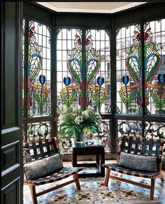 Maybe different colors and design but love the idea of a stained glass sunroom or nook.