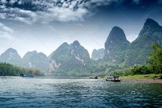 guilin ...  asia, bamboo, beauty, boat, china, chinese, countryside, famous, fishing, float, forest, formation, green, guangxi, guilin, hills, jiang, karst, landscape, li, long, mountains, nature, painted, picture, raft, reflection, river, rock, rural, scenery, scenic, shore, sightseeing, sky, terrain, tour, tourism, travel, tree, trip, vacation, veil, village, water, waterway, wilderness, yangshou