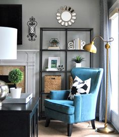 interior design, shop this room, affordable, chairs, accent chair, elliot chair, pacific blue elliot chair, pacific blue, blue, teal, turquoise, gray, grey, tufted sofa, nail head chair, urban outfitters, ikea, ikea vittsjo, floor lamp, shelving, mantel, mantel shelving, mantel shelf, mantel bookcase, book case, white chair, club chair, wingback chair, rug, rugs usa, overstock, gallery wall, black frames, minted art, art, abstract art,