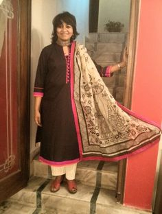 A happy client, Lopa in a black cotton kurta with pink and red piping, teamed up with a beautiful madhubani dupatta and beige palazzos.  Get styled by #chanderitiramisu!  #stylish #red #black #kurta #madhubani #dupatta #sari #palazzo #clientdiaries #happyclient #ootd #potd #indianstyle #indianclothes #indianfashion #delhi #delhistyle #desi #designer #getthelook