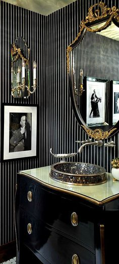 Masculine powder room with dark palette and black and white striped wall treatment #powderroom #bathroom #interiordesign - More wonders at www.francescocatalano.it
