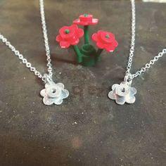 Pretty little sterling silver lego daisy pendants.